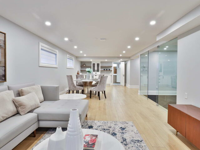 modern open space basement with small kitchen and dining room - custom home experts