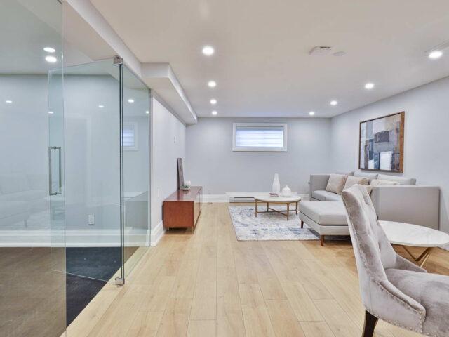 custom basement with glass door and enclose - custom home builders