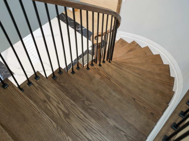 custom staircase with wooden stairs and railings - toronto custom home builder