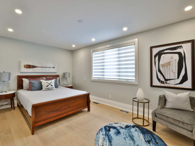 custom bedroom with amazing wall painting and baseboard decor