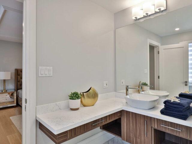 custom vanity in amazing bathroom by torino construction