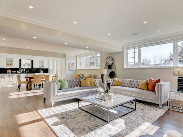 modern family room with crown moduling and beige wall paint - custom home expert