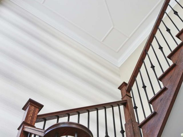 Home Renovation Project Hallway with Wooden Railings